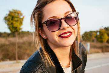 Portrait of young woman with sunglasses smiling