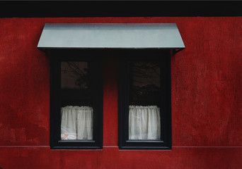 red building  wall with black windows
