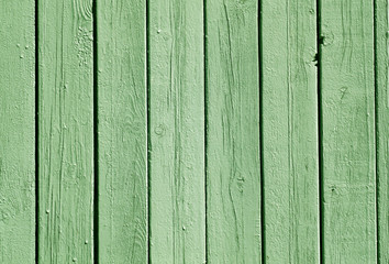 Green color wood fence pattern.