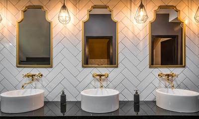 Washbasins and mirrors gold toned