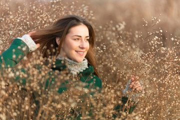 Portrait of beautiful young woman in a field