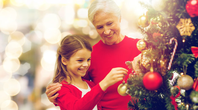 grandmother and granddaughter at christmas tree