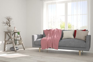 Idea of white minimalist room with sofa and shelf. Scandinavian interior design. 3D illustration
