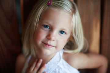 Portrait of Blonde Child Wearing White
