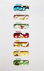 Medicine concept: medicine holder for each day of the week