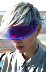 Futuristic woman in purple visor