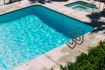 Step Ladder Leading Into Bright Blue Swimming Pooll