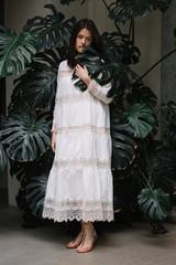 Elegant dark-haired woman in white dress