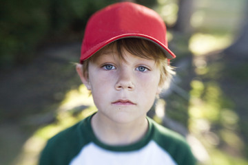 Boy Wearing Red Baseball Hat