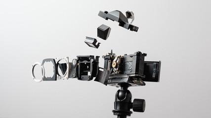 Deconstructed Analog Camera on a Tripod