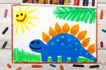 Photo of colorful drawing: Smiling dinosaur. Big blue stegosaurus.