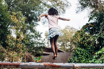 African American girl on a trampoline