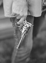 older woman holding a gun
