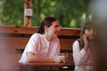 Young woman with friends at outdoor restaurant