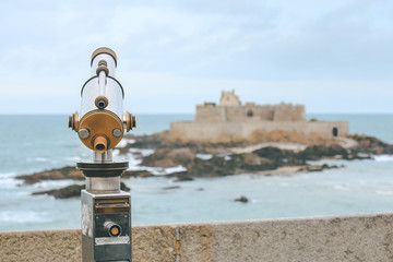 Telescope and View from corsair town of Saint-Malo, Normandy, France--one of the most visited tourist sites in France