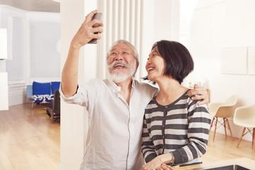 Senior couple taking selfie together