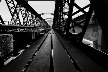 Black and white image, perspective view of old railway bridge