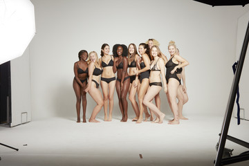 Group of body positive women posing