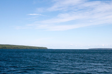 Blue water of Lake Superior and a green Apostle Island