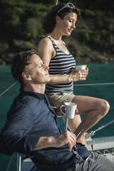 Couple drinking coffee on yacht