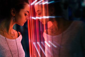 Girl posing near glowing window