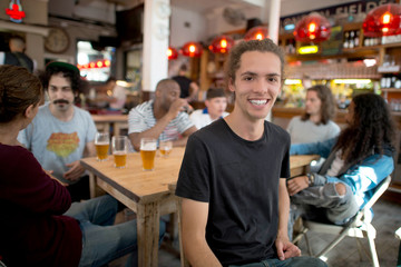 Young man with friends at bar