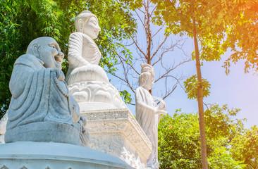 Buddha, Happy Buddha and Guanyin statue at Wat Ratchakirihirunyaram in Phitsanulok, Thailand.