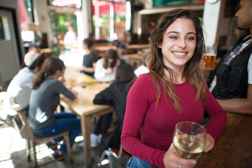 Young woman sitting at bar