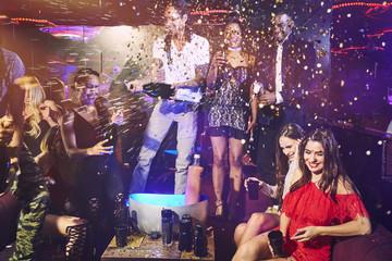 Friends celebrating at nightclub