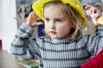 Close-up of little girl wearing yellow helmet
