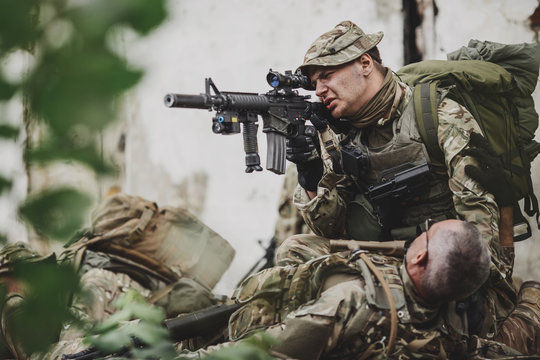 Army soldier during the military operation in the city. war, army, technology and people concept.