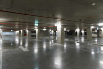 Blurred image of empty underground cars parking.