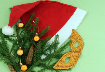 hat of Santa Claus with Christmas tree and a mask
