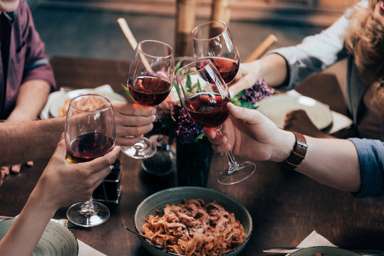 friends drinking wine at dinner