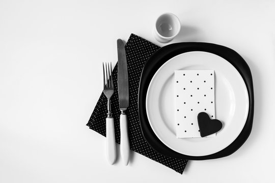 Black and white dinner setting in Nordic style