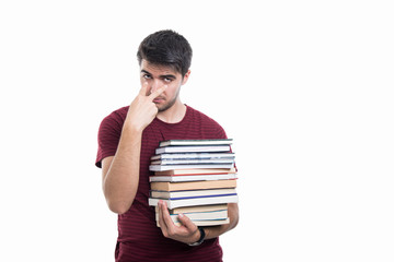 Student holding pile of books showing look into eyes