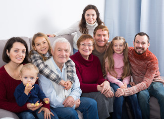 Happy family making numerous photos