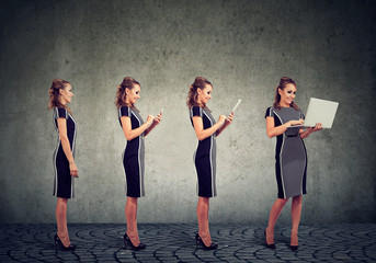 Modern digital devices and technology progress concept. Business woman using mobile phone, tablet and laptop computer
