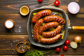Delicious roasted sausage on wood
