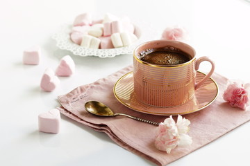 pink cup with coffee and marshmallows pink hearts on a white background