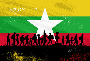 Silhouette of refugees people walking with flag of Myanmar as a background