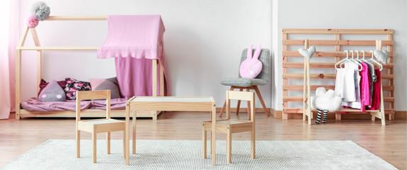 Pastel pink kid room interior