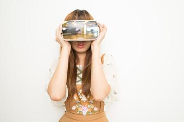 Asean woman in brown dress wearing VR