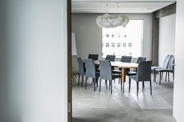 Empty boardroom with flipchart