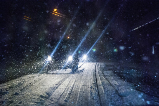 Car driving during winter snowstorm. Motion blur.