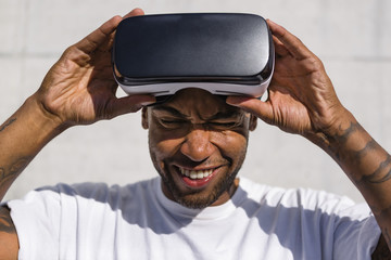 Man putting on Virtual Reality Glasses