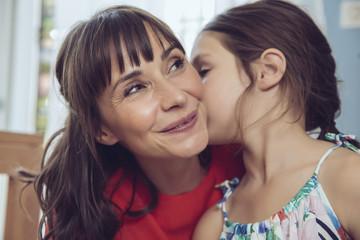 Daughter telling mother a secret