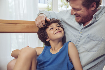 Father tickling son's head