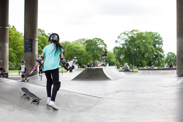 Powerful funny young guys are trained in a skate park