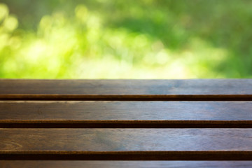 Table on a green background outdoors